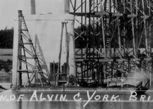close up of the barge shows two working men and details of the ...